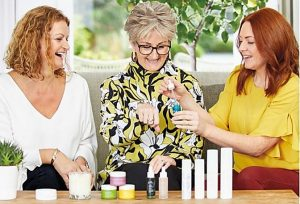 www.penelopedunlop.com - who are the award-winning Tropic Skincare - an image showing a Tropic Ambassador showing two ladies some of the products